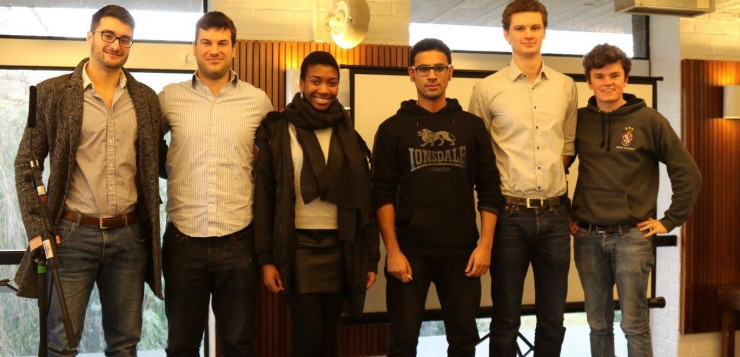 PopUp are announced as the winners and pose with the judging panel and Enactus member.