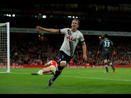 Harry Kane celebrates scoring against North London Rivals Arsenal