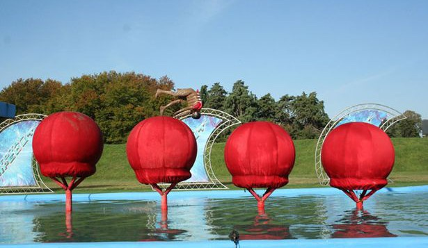 A contestant takes on the Total Wipeout course