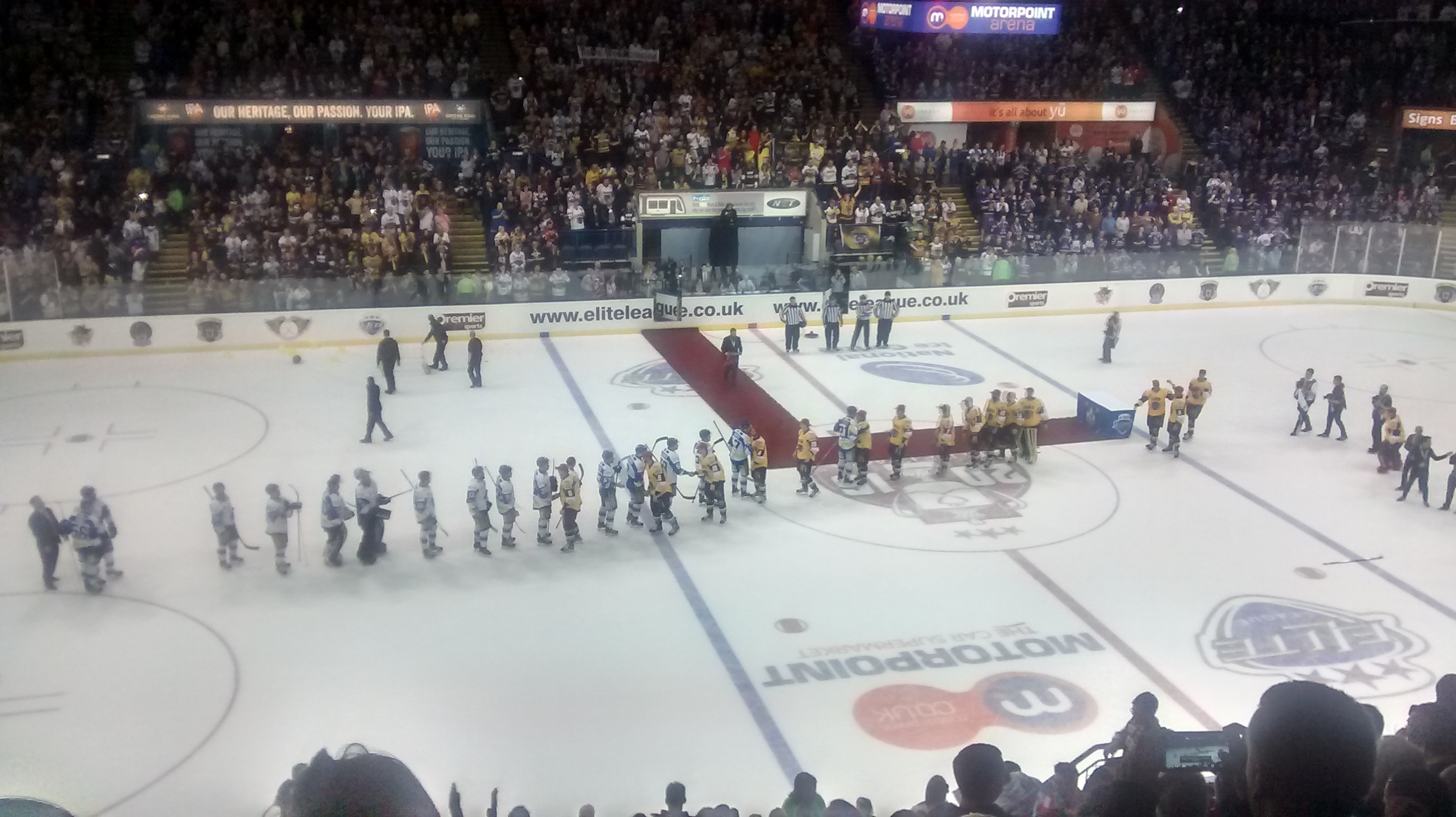 The two teams shake hands as Nottingham emerge as victors.