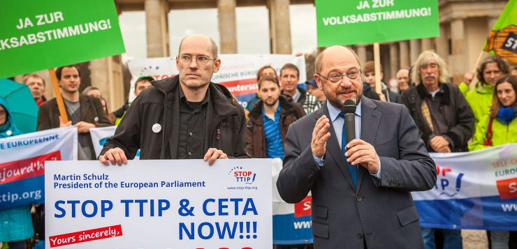 Protesters hand a petition against TTIP to EU Parliament President Martin Schulz