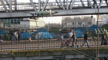 Migrant Camp under a metro bridge in Paris.