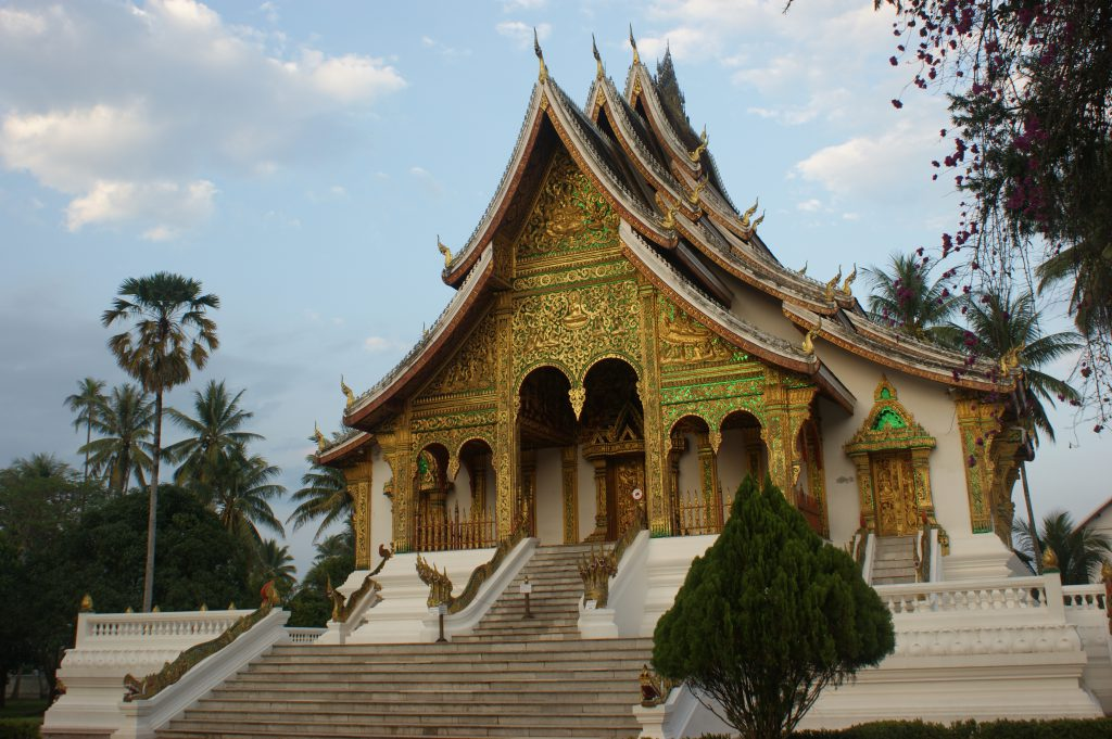 An incredibly opulent gold and emerald tinted temple at the site of the former king's palace.