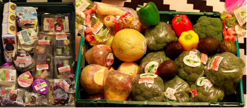A large pile of vegetables, fruit and ready meals collected from bins.