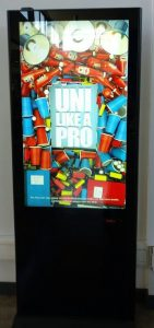 A photograph of one of the ads, the body of the text reads UNI LIKE A PRO, referring to the benefits of caffeine pills.