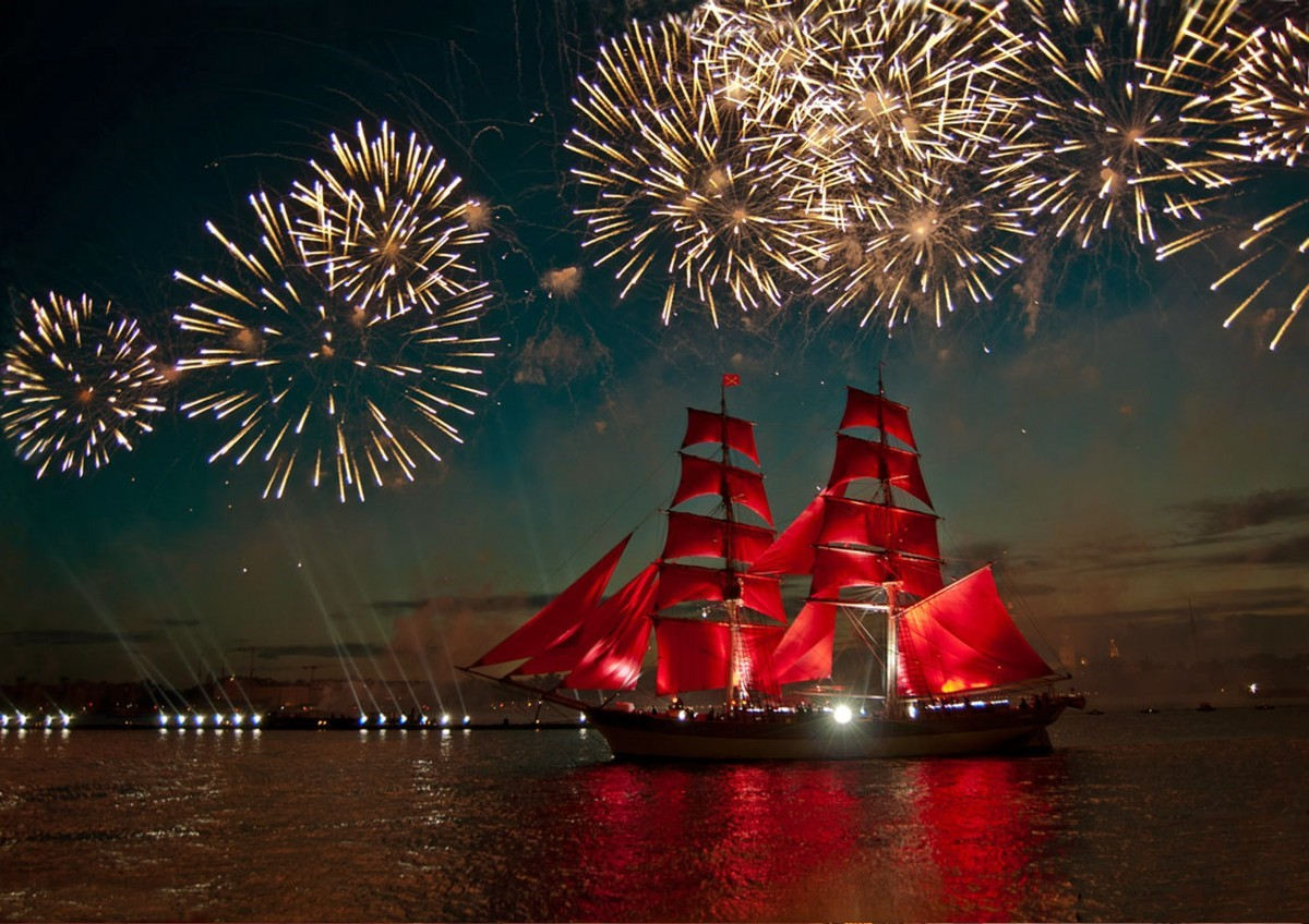 Scarlet Sailed ship sailing to the backdrop of fireworks