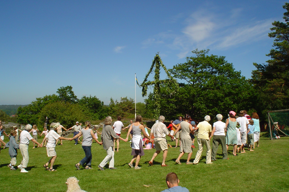 Dancing around a maypole in Sweden for summer solstice