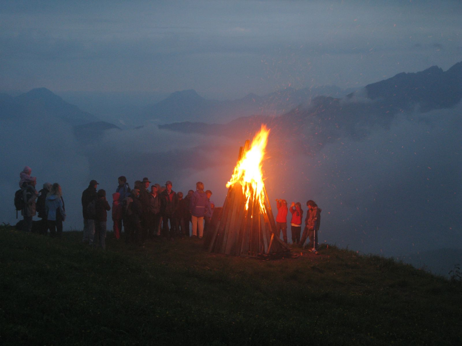 bonfire on a mountain in Austria during summer solstice