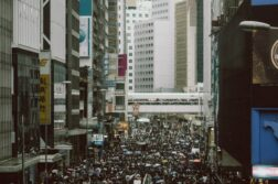 An overhead view of an urban crowd on an overcast day
